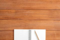 Creative flat lay photo of workspace desk. Office desk wooden table background with open mock up notebooks. stock images