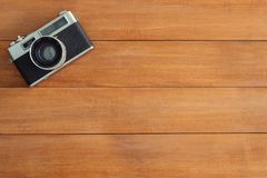 Minimal work space - Creative flat lay photo of workspace desk. Office desk wooden table with old camera. Top view with copy space. Top view of old camera over stock images