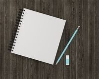 Minimal work space : notebook with blue pencil, eraser on wooden. Table background. Vintage picture tone, Top view , flat lay, The idea about the work that has Stock Photography