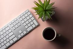 Minimal workspace with electronic goods and espresso coffee on p stock photography