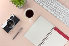 Minimal workspace with technology equipment on pastel pink background royalty free stock photos