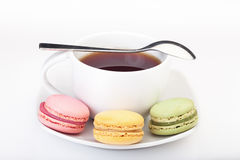 Minimalism: English tea and French macaroons. Multicultural minimalism: English tea and French macaroons stock photos