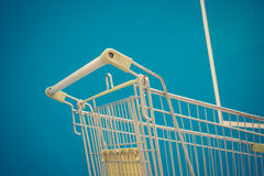 Minimalism style, Shopping cart and blue wall. Minimalism style, Shopping cart white green color and blue wall at supermarket. , process in vintage style Royalty Free Stock Image