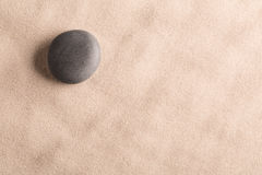 Minimalism zen background with black stone in sand royalty free stock photos