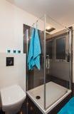 Minimalist apartment - bathroom. Minimalist apartment - modern bathroom with a glass shower Royalty Free Stock Photos