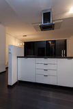 Minimalist apartment - kitchen with hood Stock Image