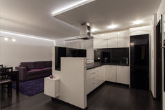 Minimalist apartment - kitchen and living room royalty free stock photos