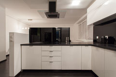 Minimalist apartment - small kitchen Royalty Free Stock Photography