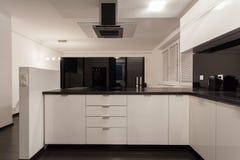 Minimalist apartment - small kitchen Royalty Free Stock Photography