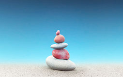 Minimalist background of stones over blue sky Stock Images