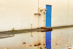 Blue door reflects in flood waters royalty free stock image