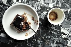 Minimalist breakfast with coffee and chocolate cake Royalty Free Stock Images