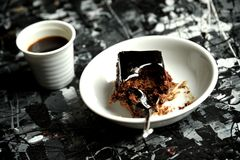 Minimalist breakfast with coffee and chocolate cake. Italian breakfast with espresso coffee and chocolate cake on an abstract art table. artistic setting for a Stock Photos