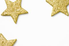 Minimalist Christmas New Year poster banner card template. Golden decorative stars on white background. Flat lay. Copy space royalty free stock image