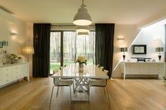 Minimalist dining room. Minimalist white dining room design with wooden floor Stock Image