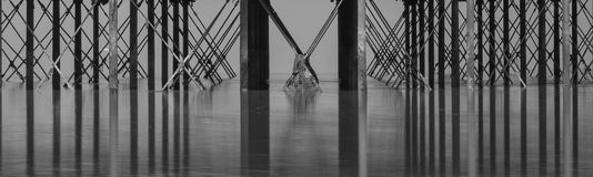 Minimalist fine art image of underside pier showing pattern of b royalty free stock images