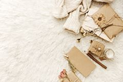 Minimalist Flat Lay Hipster Cozy home composition with sweater,. Craft elements and present . Top view Stock Photos