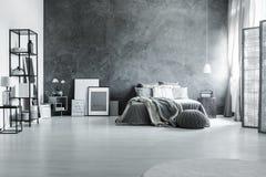 Minimalist and gray loft bedroom. Spacious loft bedroom with minimalist gray decor and metal furniture stock photos