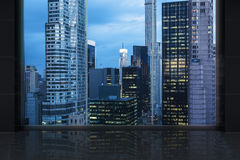 Minimalist interrior with a huge window and panoramic New York city. Royalty Free Stock Photos