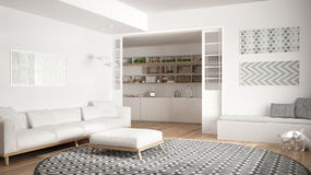 Minimalist living room with sofa, big round carpet and kitchen i Stock Photo