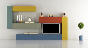 Minimalist lounge with colorful wall unit Stock Photos
