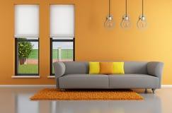 Minimalist orange vardagsrum Royaltyfria Foton