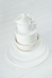 Minimalist picture of white porcelain kitchenware piled up Royalty Free Stock Photo