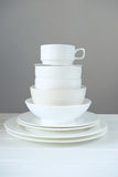 Minimalist picture of white porcelain kitchenware piled up Stock Photos