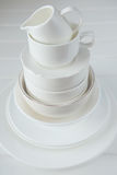 Minimalist picture of white porcelain kitchenware piled up Royalty Free Stock Photography