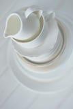 Minimalist picture of white porcelain kitchenware piled up Stock Image