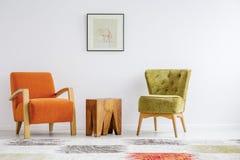 Minimalist retro stylization. Minimalist interior stylization with two retro armchairs Stock Photos