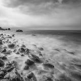 Minimalist seascape. Long exposure of sea and rocks Royalty Free Stock Image