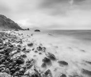 Minimalist seascape. Long exposure of sea and rocks. Royalty Free Stock Photos