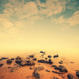 Minimalist seascape scene. Stones in water Royalty Free Stock Photos