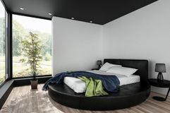 Minimalist bedroom with round double bed Stock Photography