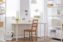 Minimalist teen room. White furniture and wooden chair - minimalist teen room Stock Photo