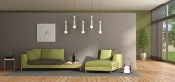 Minimalist vardagsrum med den gröna soffan Arkivfoto