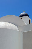 Minimalist view of white chapel with blue dome Royalty Free Stock Images