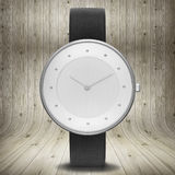 Minimalist watch on wooden background Royalty Free Stock Images