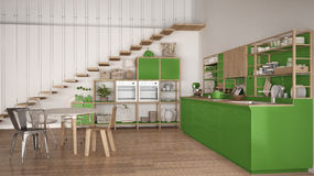 Minimalist white and green wooden kitchen, loft with stairs, cla Royalty Free Stock Image