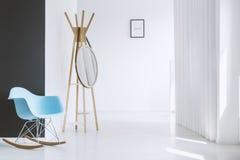 Modern blue rocking chair Stock Photos