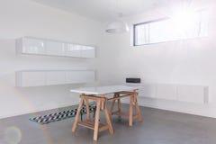 Minimalist white modern room stock photography