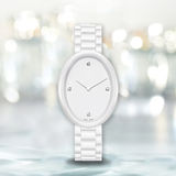 Minimalist white watch on bright blurry background Royalty Free Stock Photography