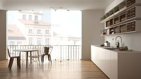 Minimalist white and wooden kitchen with dining table and big panoramic window. City, old town panorama in the background. Eco hou. Se interior design stock photo