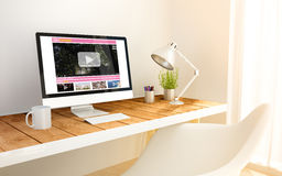 Minimalist workplace with video streaming computer Stock Photography