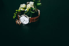 Minimalist wristwatch black dial on white background Royalty Free Stock Images