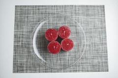 Minimalistic advent wreath, four candles on glass plate Stock Image
