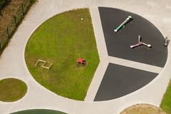 Minimalistic aerial view of round playground for children with simple lines and sport equipment. Minimalistic aerial view of green small sport stadium field royalty free stock images