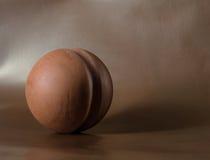 Minimalistic brown ceramic ball Stock Photos
