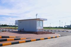 A minimalistic bus station with a bicycle nearby stock image